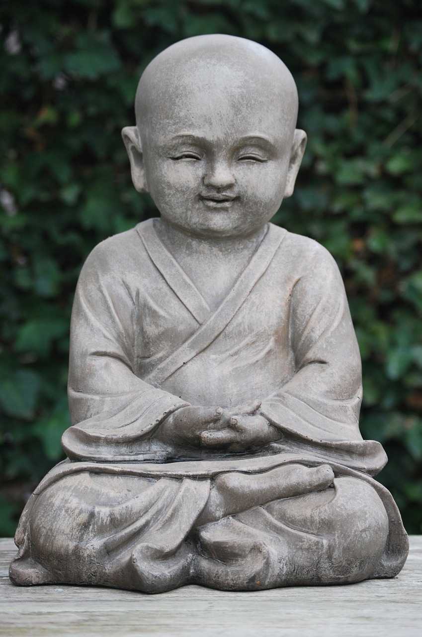 Little Buddha Statue Meditating and Being Happy!