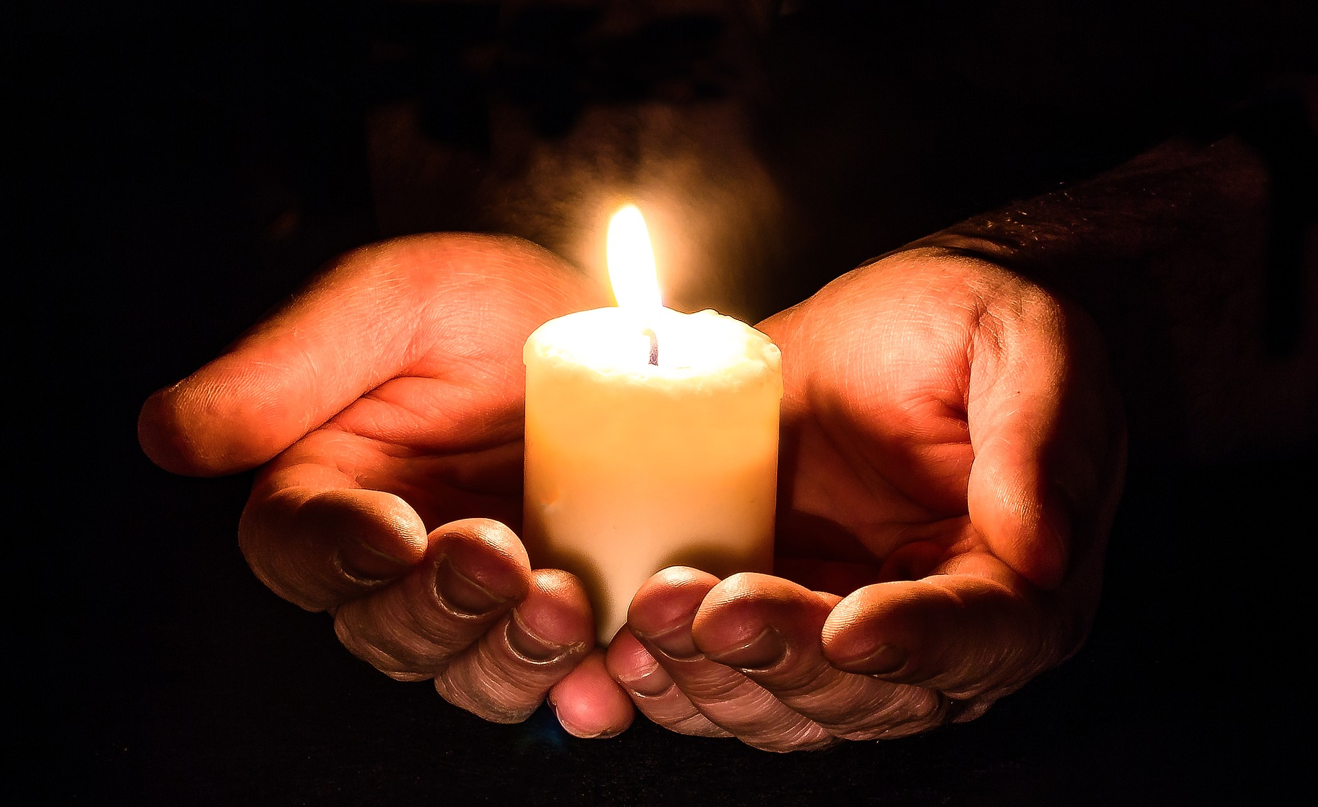 Hands with a Candle