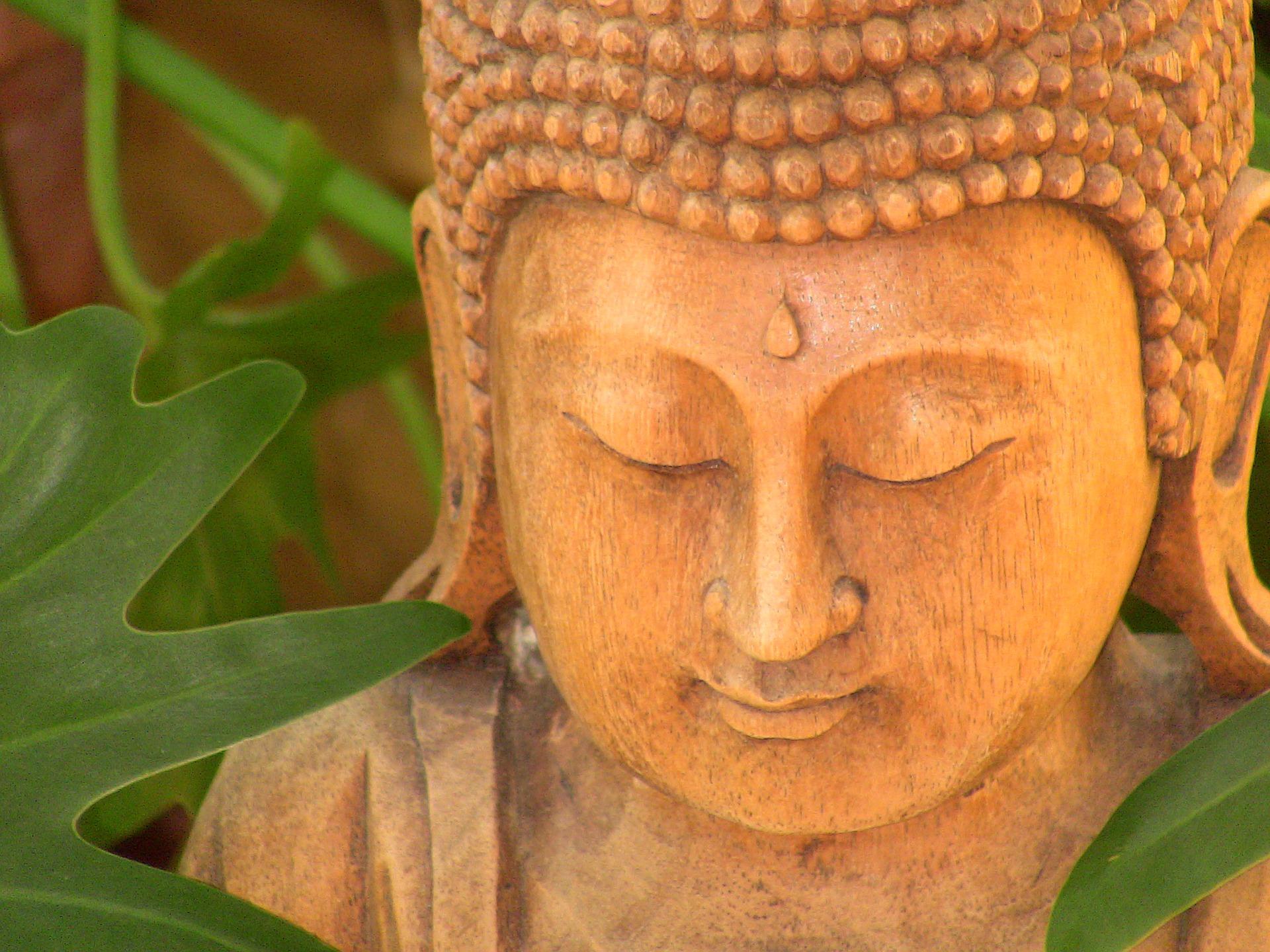 Wooden Buddha Smiling