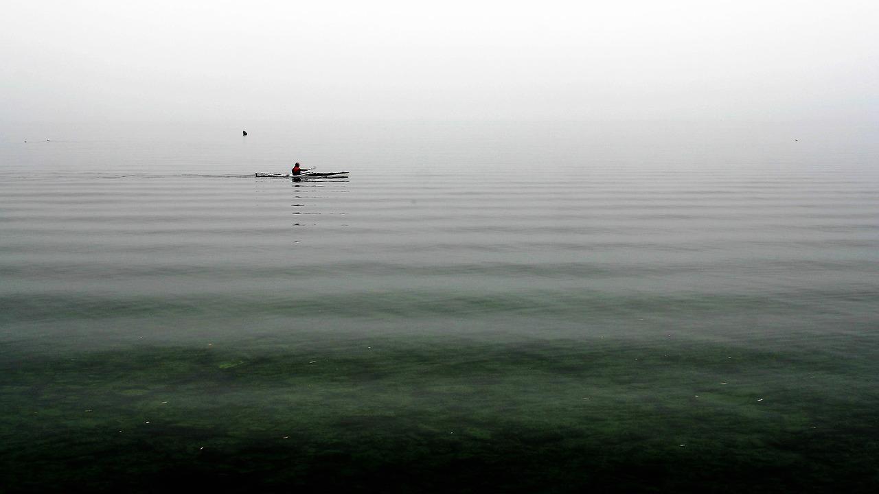 kayak floating on wavy waters