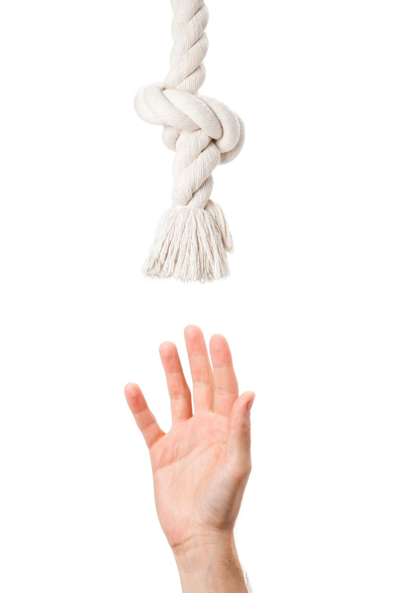 Hand attempts to grab a rope