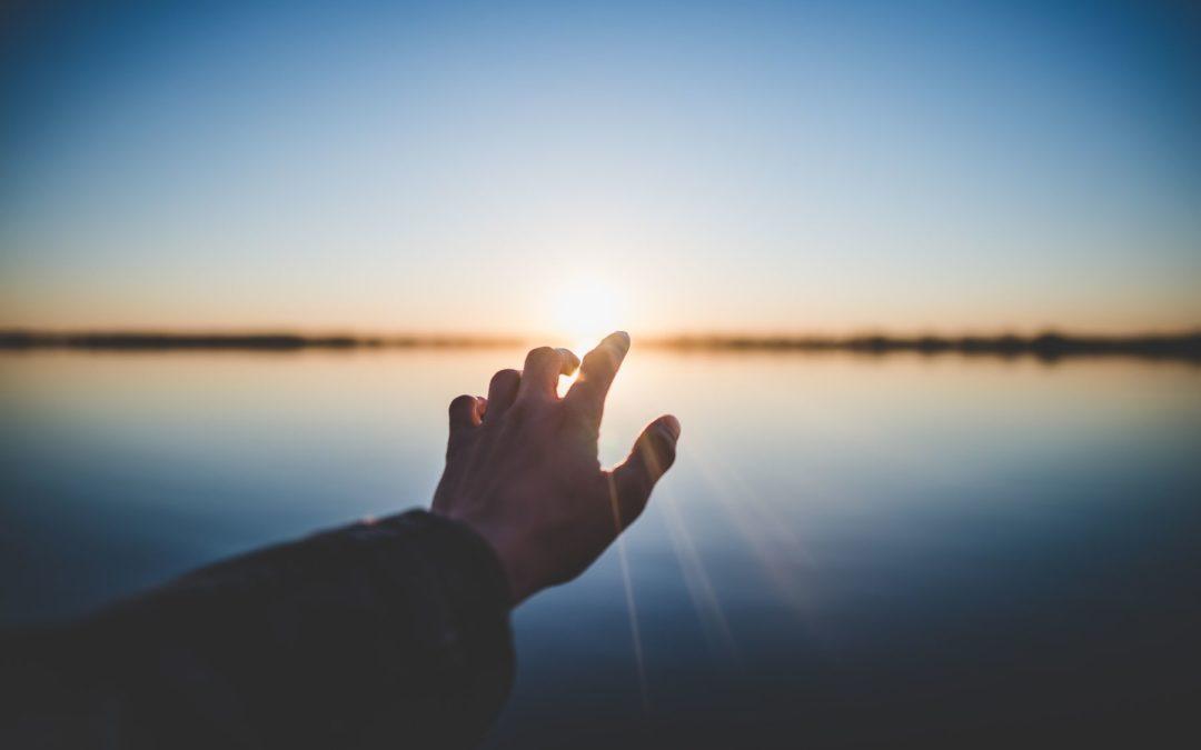 Man holding hand on sun