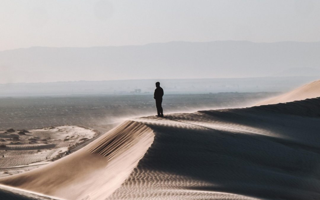 Man standing on the dunes